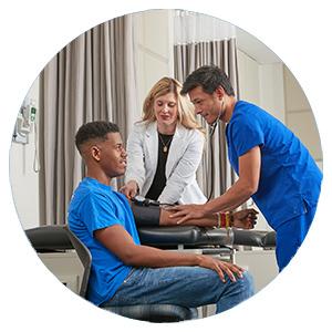 School of Health Studies students practicing taking blood pressure
