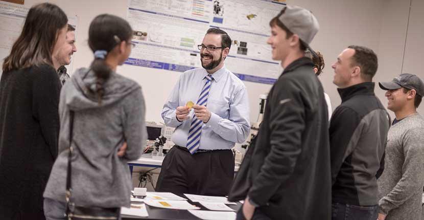 Professor instructing students