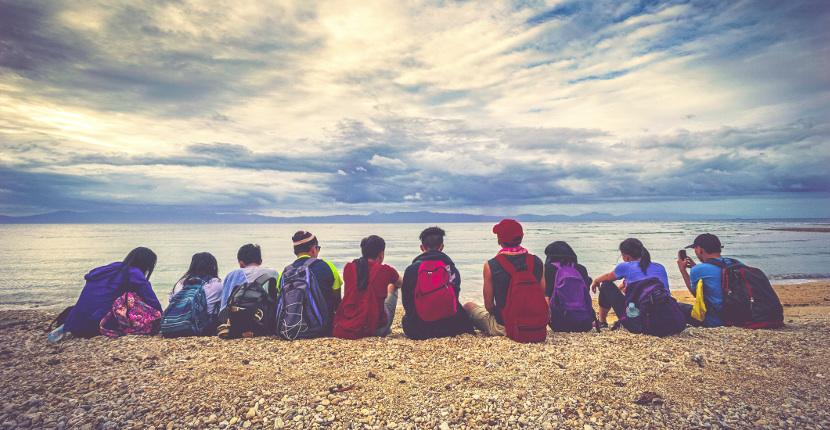 Study Abroad - Students sitting on a coast