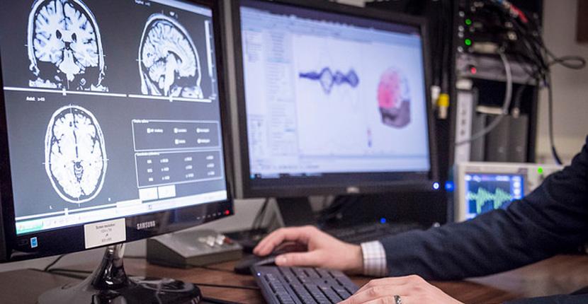 Dr. Bidelman displays EEG