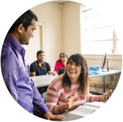 student in class speaking to teacher