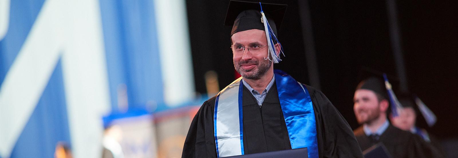 adult student at graduation