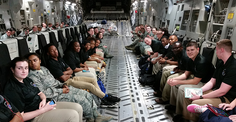 Air Force team aboard hangar airplane