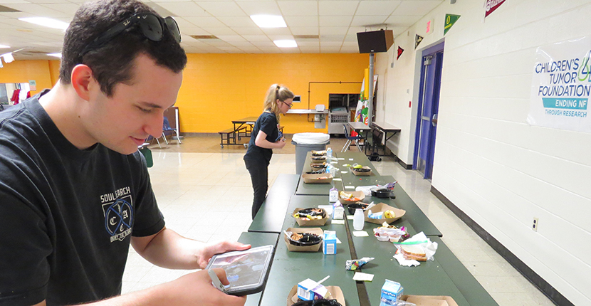 After taking Ethnographic Methods, Paul Dygert and Alexandria Spann (undergraduate anthropology majors) collect data for Dr. Trapp's lunch plate analysis study.