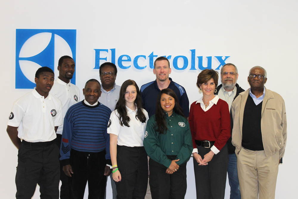 Dr. Robert Connolly (second from right) with Electrolux Team Members