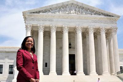 Kristen Clarke in front of Supreme Court
