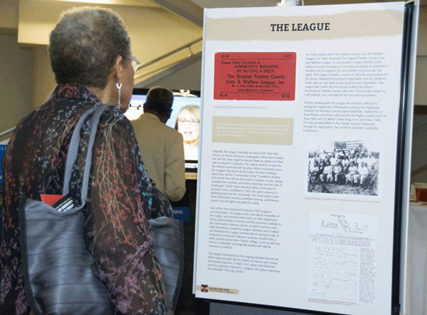 Attendee views a panel from the Uplift the Vote exhibit at the Ned McWherter library. Fall 2018.