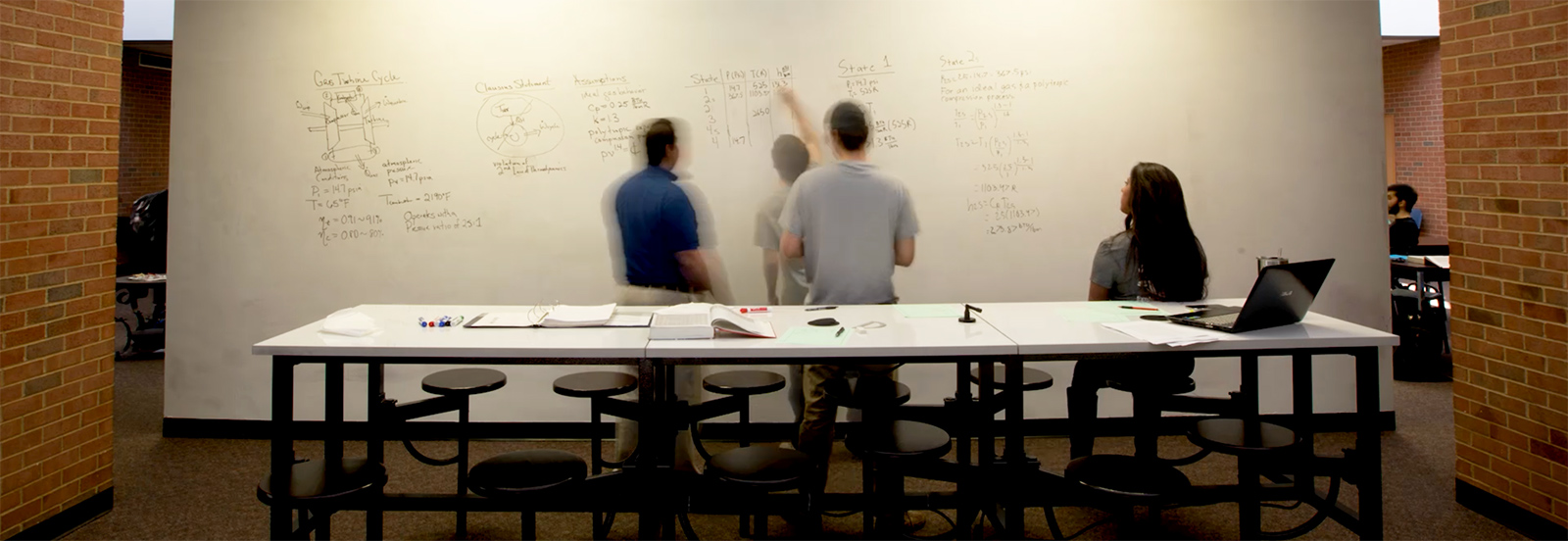 Students Working on a Whiteboard