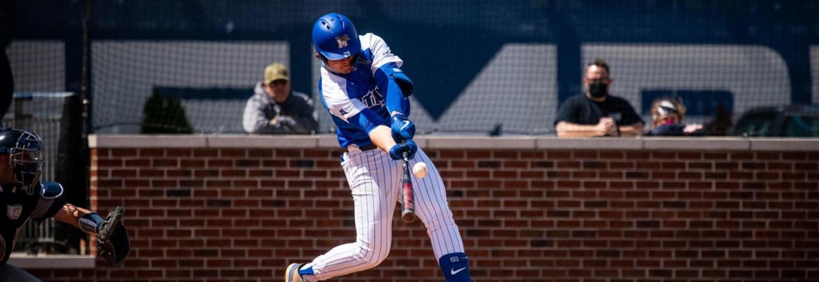 Alec Trela hitting a baseball with baseball bat