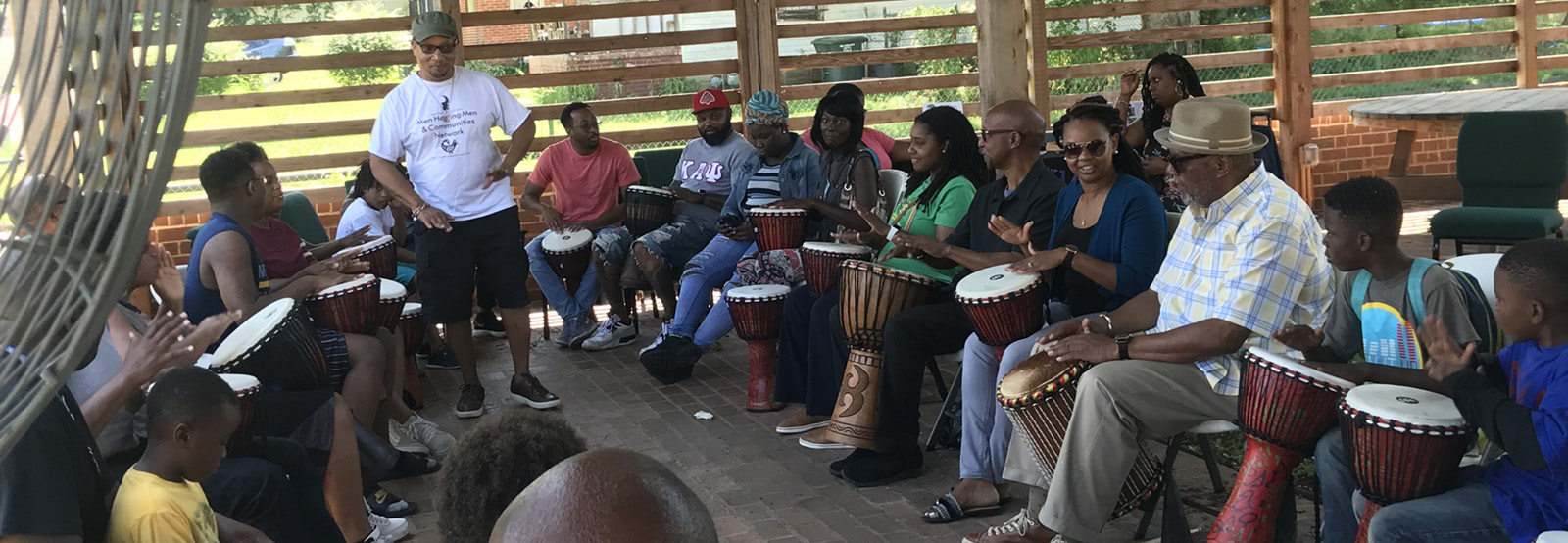 Picture of participants drumming at the pavilion