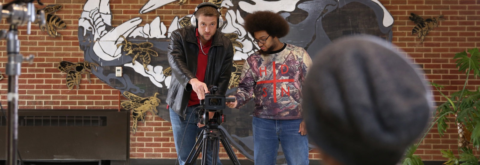 students filming a video