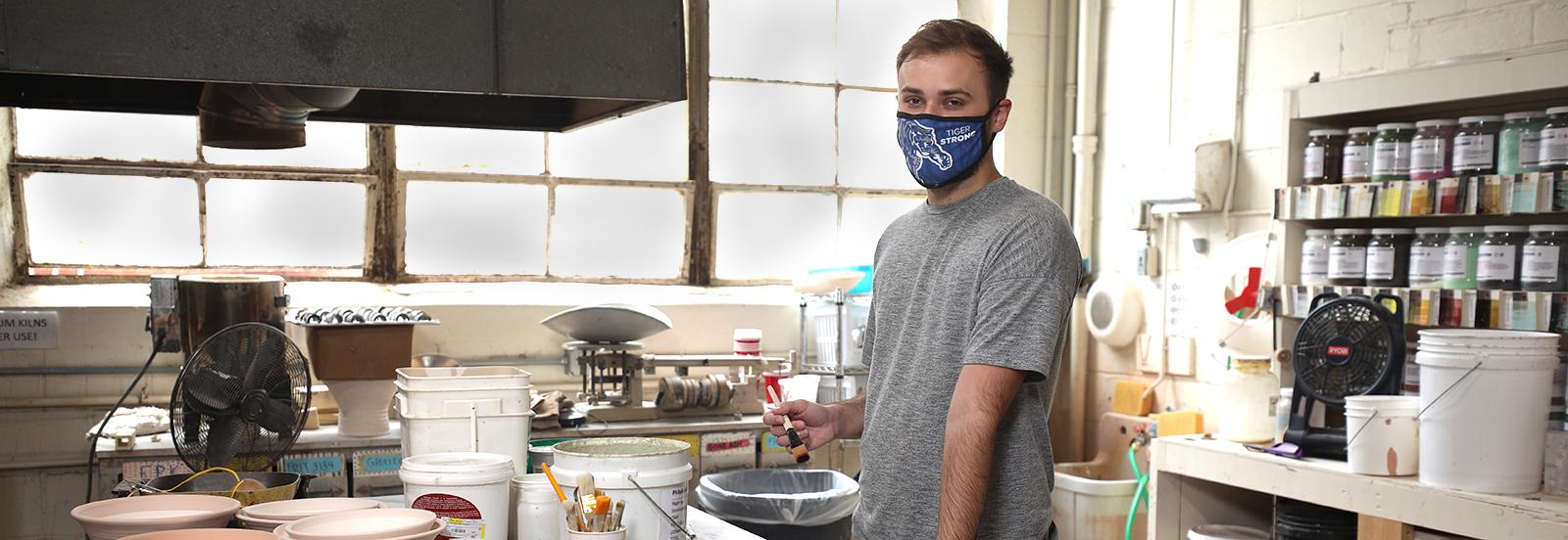 art student wearing mask
