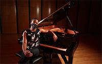 piano player wearing mask
