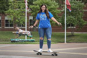 student riding skateboard