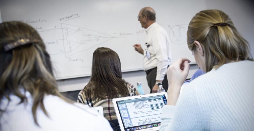 Dr. Herb Gould teaches class.