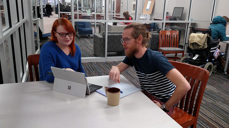 two students studying at Center For Writing and Communication