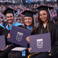 UofM graduates showing off hard-earned degrees