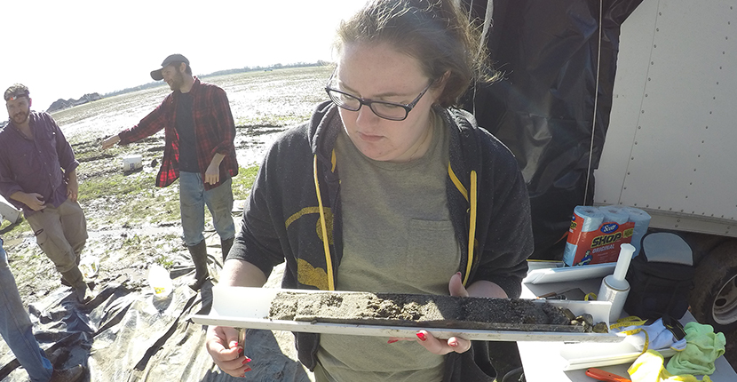 Graduate student Audrey Eason with undergraduate student Nick Jackson in background, Meeman-Shelby fault drilling project, Marion , Arkansas