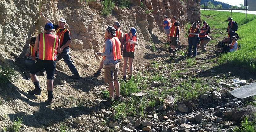 ESCI 4622, Geology Field Camp, students measuring and describing rocks at Deadwood, South Dakota.
