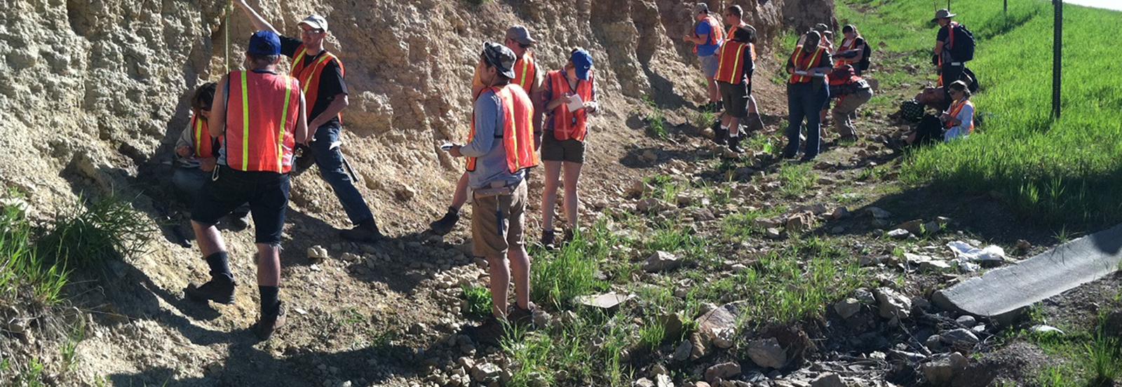 ESCI 4622, Geology Field Camp, students measuring and describing rocks at Deadwood, South Dakota.