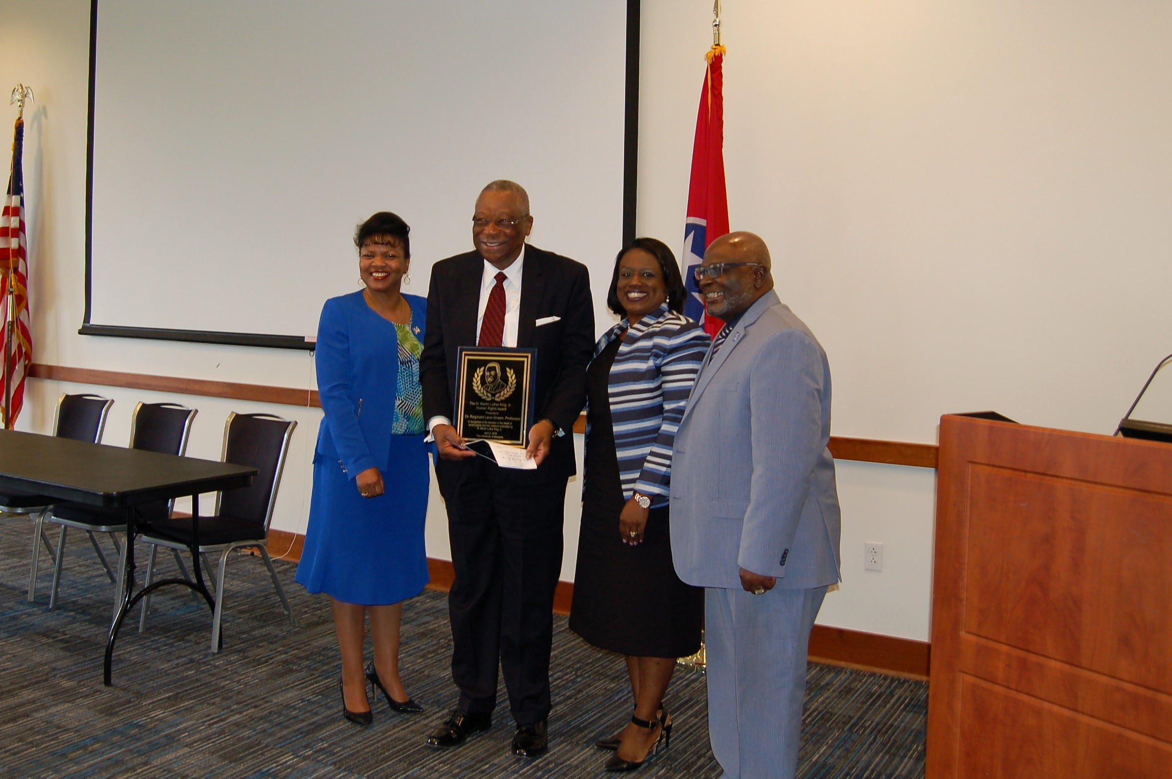 Dr. Green is given award by Dean Hill-Clarke