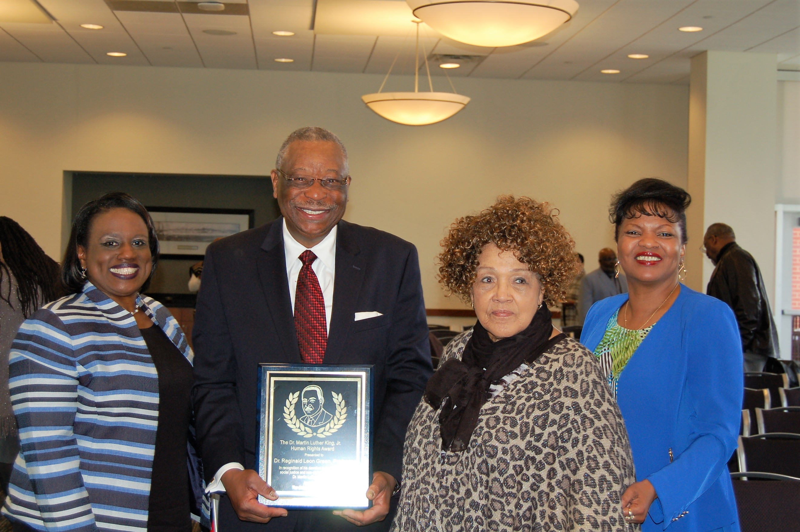 Dr. Green, Mrs. Green, Dean Hill-Clarke, and Provost Weddle-West