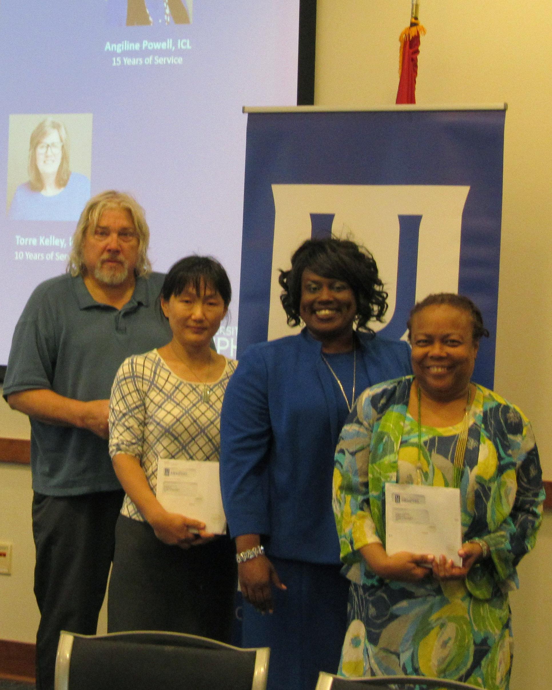 Faculty Career Milestone award winners with Dean Hill-Clarke