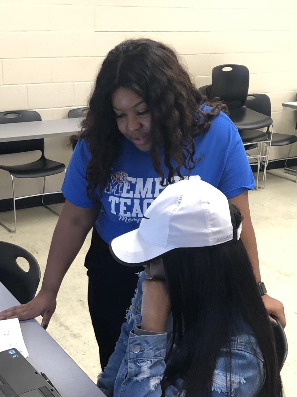 Registration station - advisor helping female student register