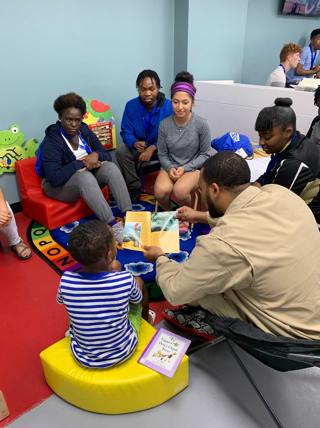 River City Summer Bridge students reading with local children