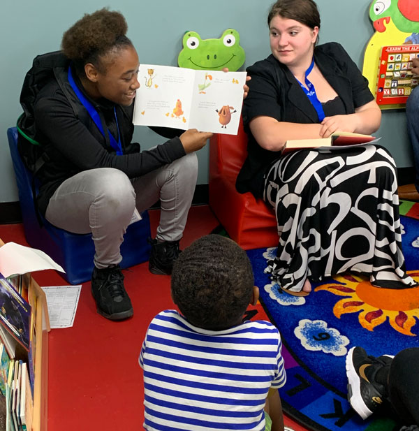 Students reading to a child