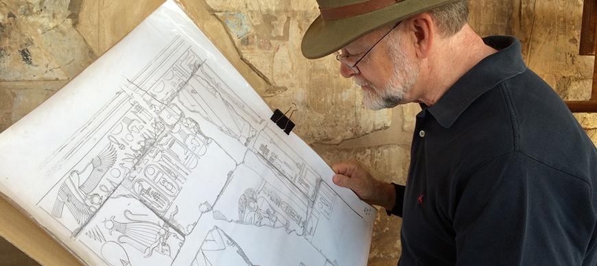 Ray Johnson checking artist's drawing