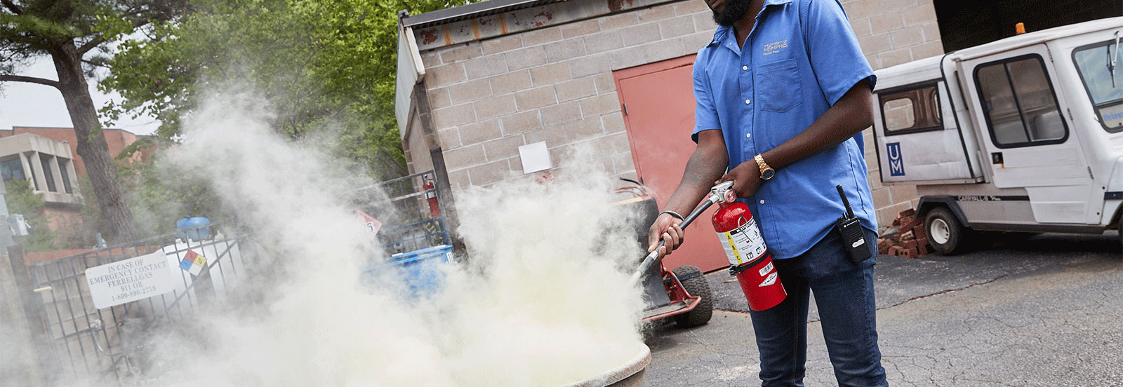 man demonstrating proper fire extinguisher use
