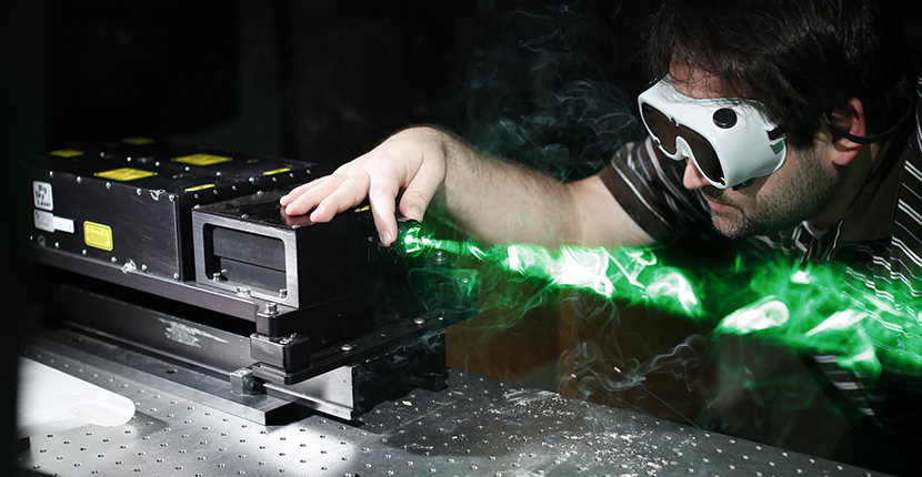 student with laser equipment