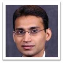 Former Fogelman College Ph.D. student, Dr. Pawan Jain