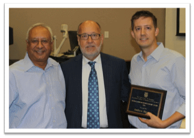 Dr. Andrew Hussey (right) with benefactor, Mr. George Johnson (center), and Dean Rajiv Grover (left) receiving the 2015 George Johnson Award.