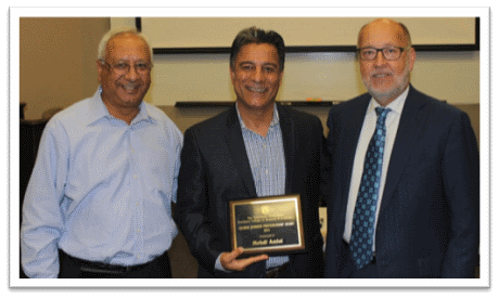 Dr. Mehdi Amini (center) as he was announced a winner of the 2015 George Johnson Award.