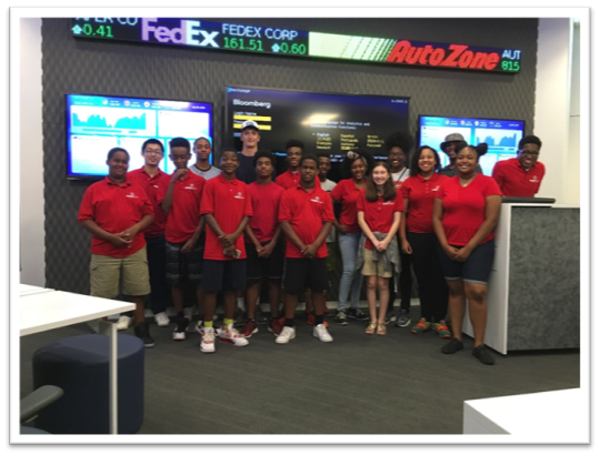 Camp participants in the Cook Analytics and Trading Lab at FCBE.
