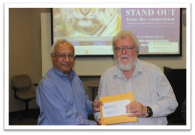 Dean Rajiv Grover with Dr. Mark Sunderman