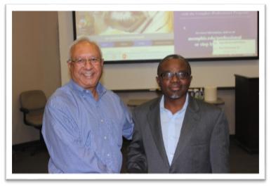 Dean Rajiv Grover with Dr. Albert Okunade