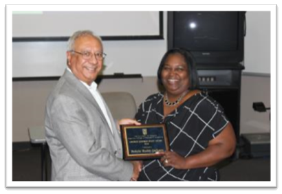 Felicia Roddy-Jackson (right) receiving the George Johnson Staff Award from Dean Rajiv Grover