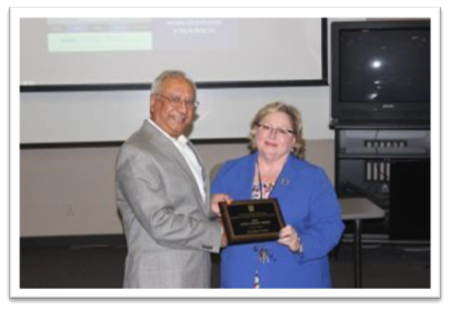 Dean Grover presenting the Dean's Service Award to Carolyn Cates (right)