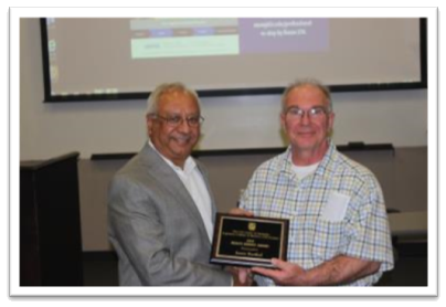 Dean Grover presenting the Dean's Service Award to Jamie Barthol (right)