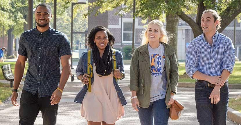 Four Students enjoy walking campus