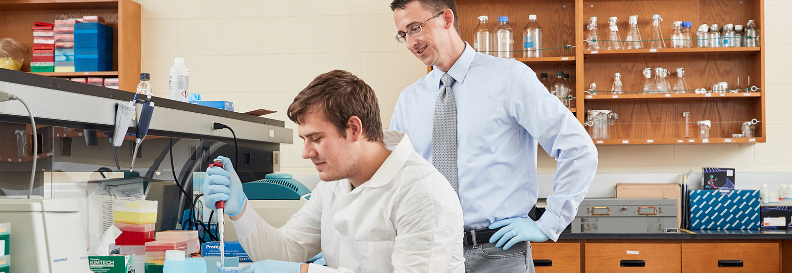 professor helping student in lab