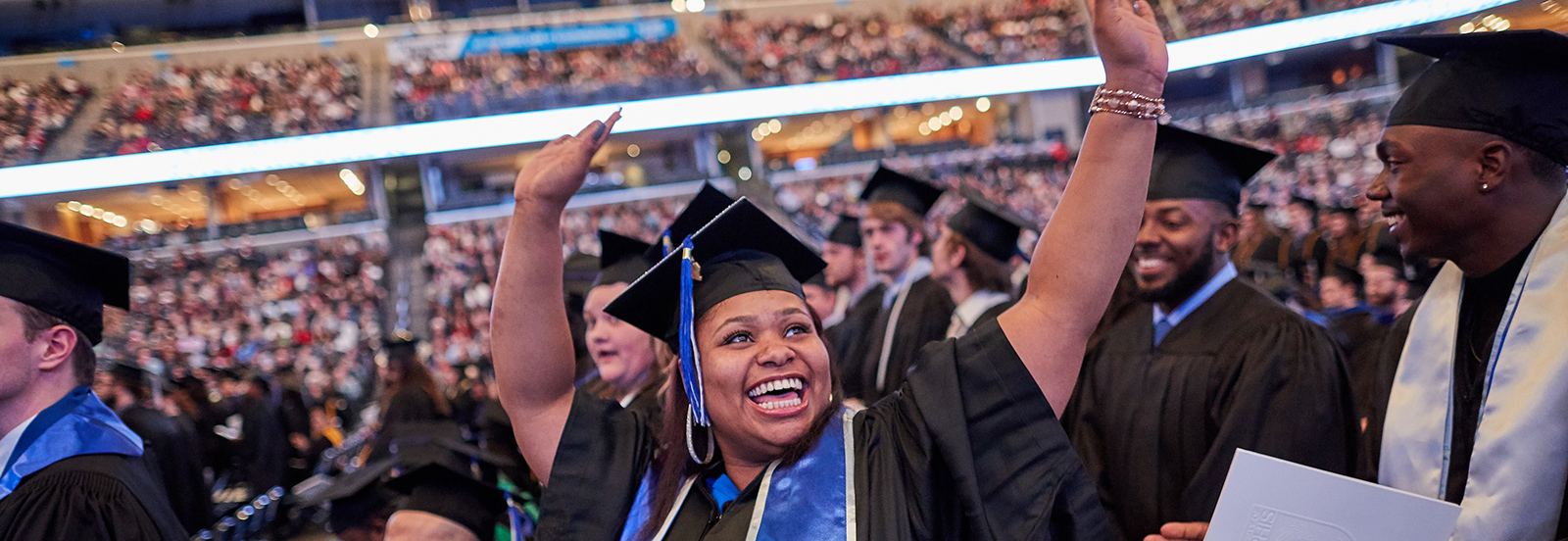 student at commencement celebrates