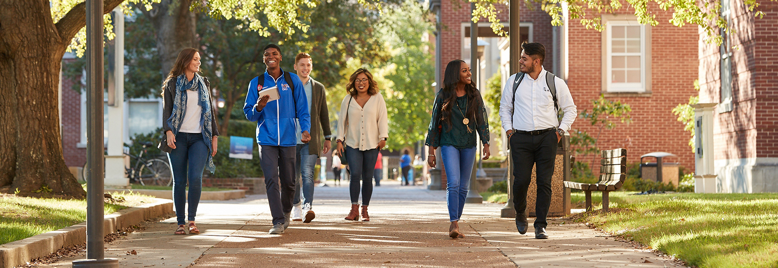 students traversing campus
