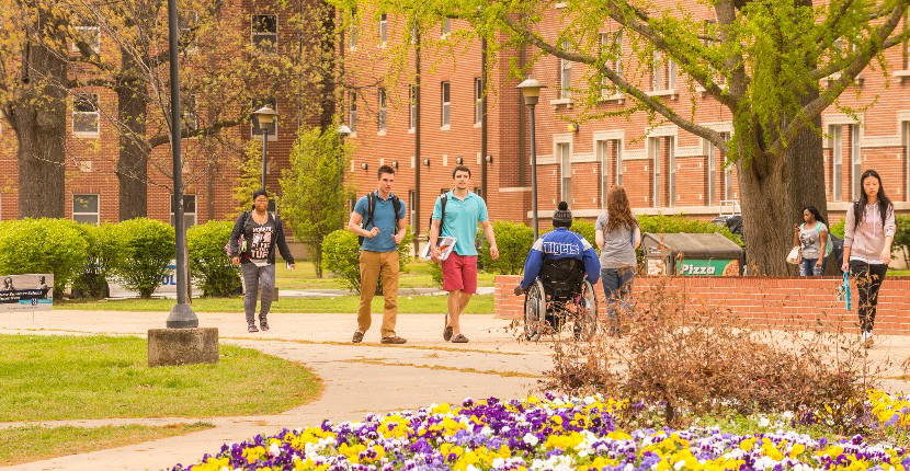 students traversing campus outside