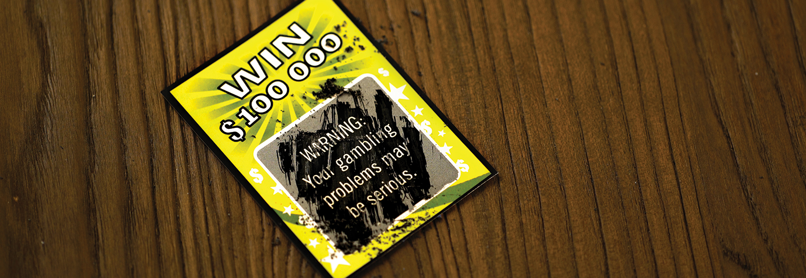 """scratch off card reads """"Warning: Your gambling problems may be serious."""""""
