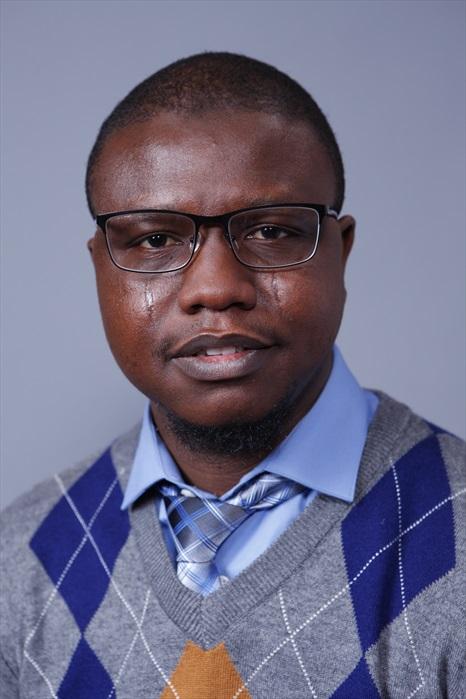 Dr. Olufadi