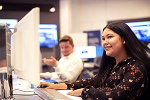 student on desktop computer